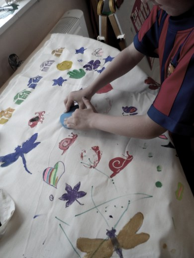 Making a Love and Kindness banner for Hate Crime awareness sessions.