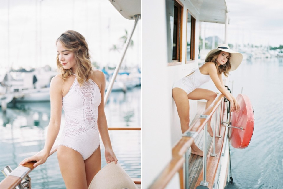 woman in white crochet swimsuit on sailboat in san diego