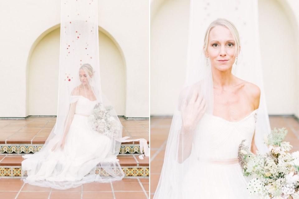 Bride Sitting On Staircase At Estancia La Jolla Wedding Venue In San Diego