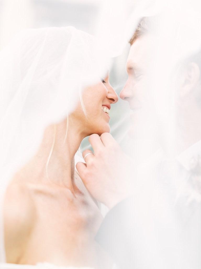Bride and Groom Kissing At Estancia La Jolla Wedding Venue In San Diego