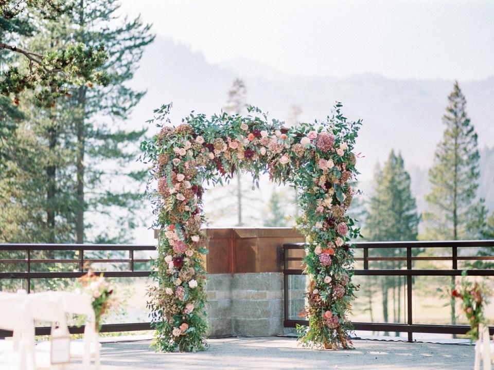 Rose filled wedding arch inspiration at Lake Tahoe wedding venue The Resort At Squaw Creek