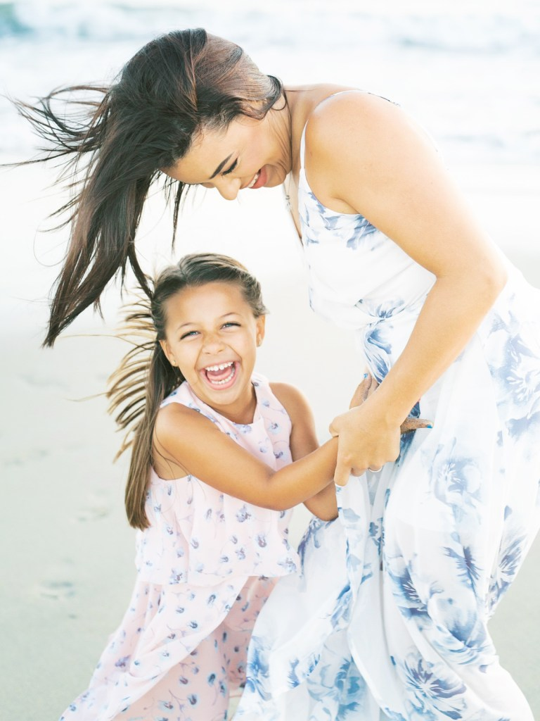 Mother and daughter laughing | | Light and airy Coronado family session shot on film by Mandy Ford
