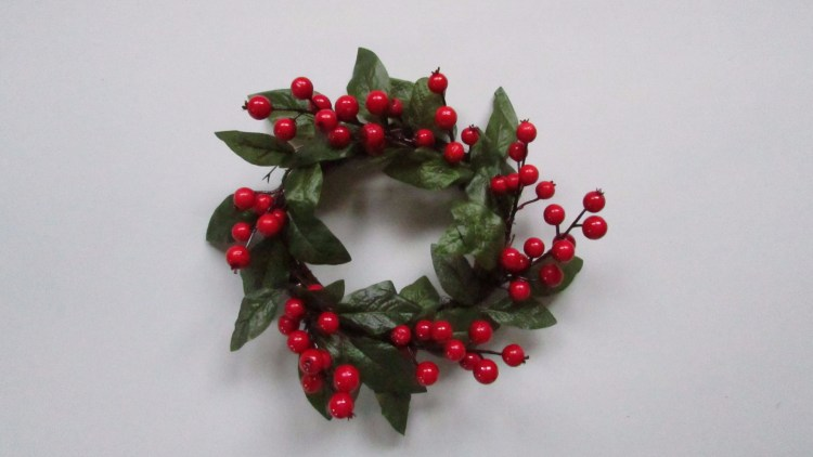 Christmas candle ring with green leaves and red berries