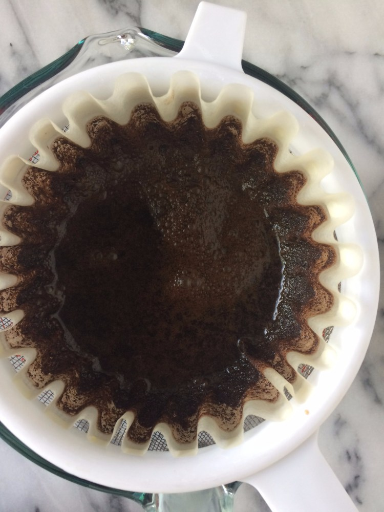 filtering cold brew in coffee filter