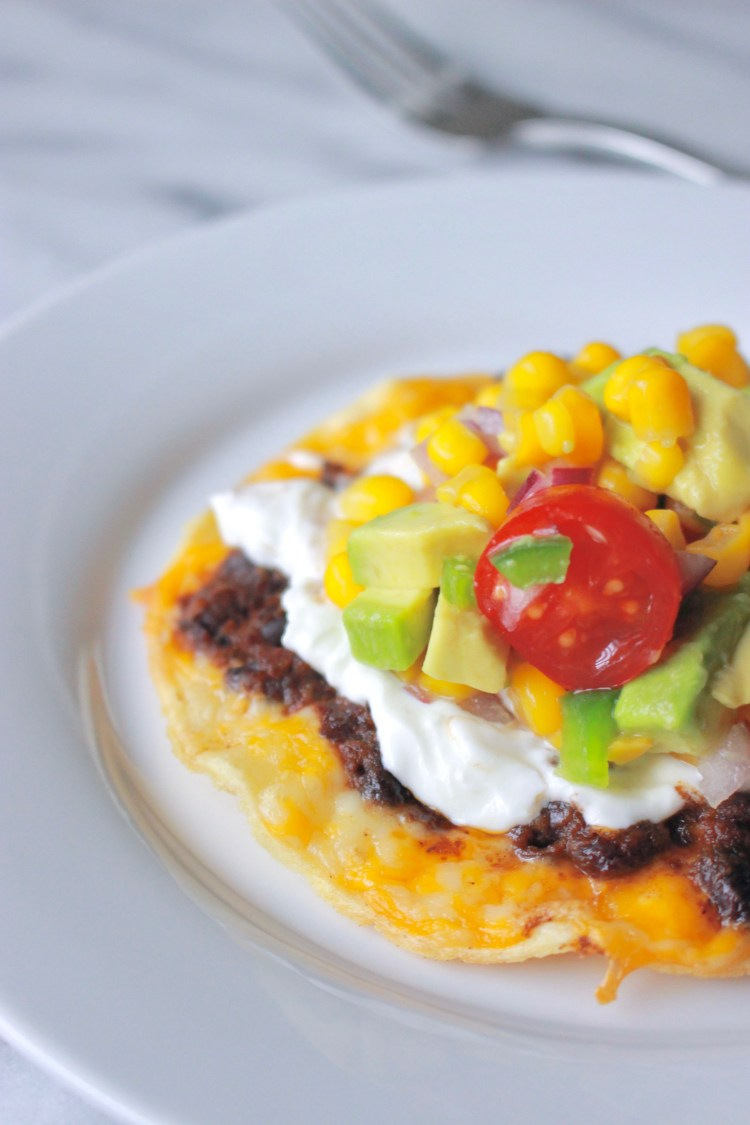 Black Bean Tacos   An easy, healthy, vegetarian tostada that's perfect for Meatless Monday and will get you geared up for Taco Tuesday. Smashed black beans and cheese get baked on a corn tortilla, then slathered in sour cream and topped with homemade corn salsa.