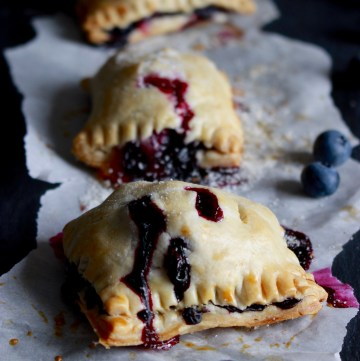 Blueberry hand pies are the perfect hand-held dessert! These homemade mini pies can be made with fresh or frozen blueberries. Use store-bought crust for an easy finger-food treat.