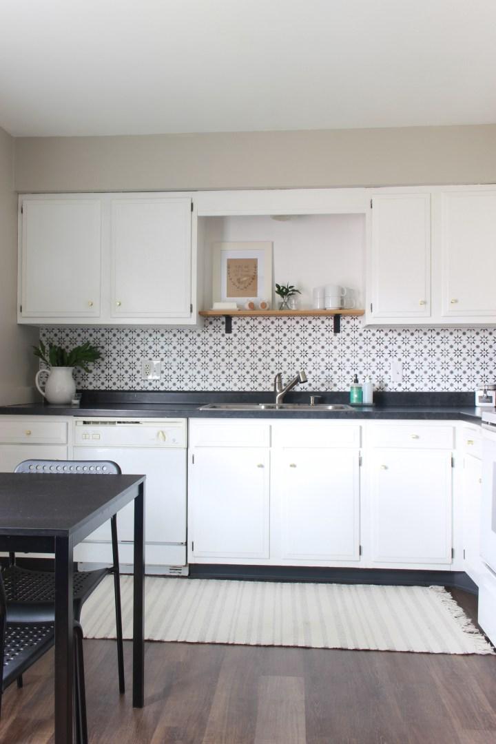 stenciled tile backsplash in the kitchen