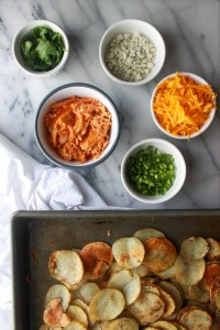 assembling buffalo chicken potato nachos