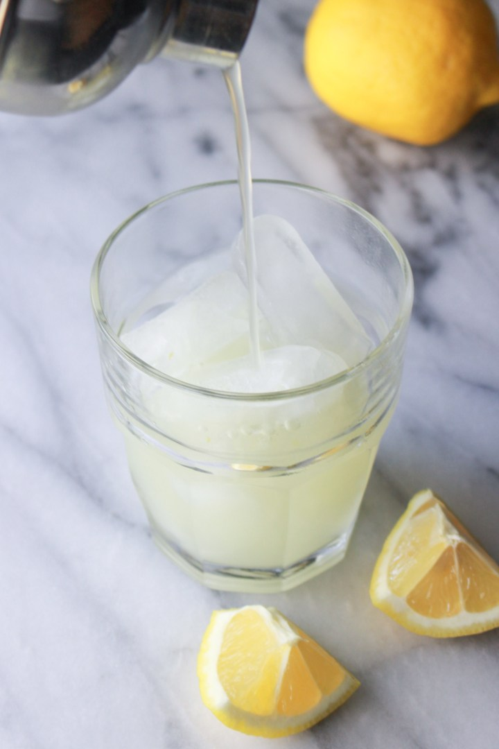 shaken lemonade being poured into a glass