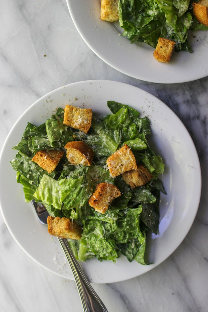 homemade caesar salad dressing on romaine