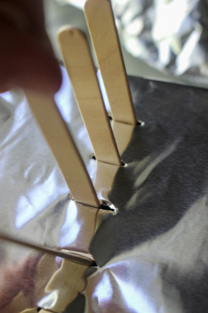 popsicle sticks in foil slots