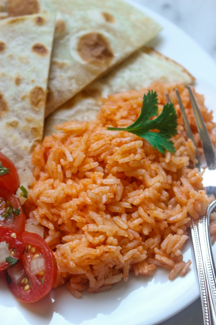 plate with spanish rice and quesadillas