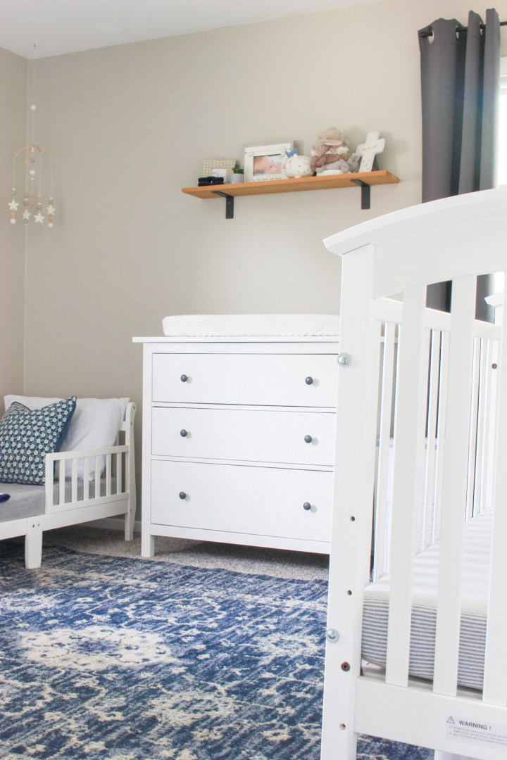 toddler bed and crib in shared bedroom