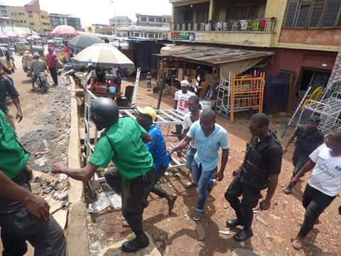 1a4d3-fb_img_1476165957825-791919 Onitsha Market Jubilates As Security Agents Nab Hoodlums Who Extort Money From Traders (Photos)