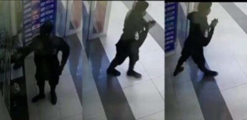 , Policeman Caught On CCTV Stealing Phone At Ghana Mall (Video)