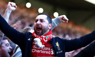 Liverpool fans celebrate during their match against Wolves