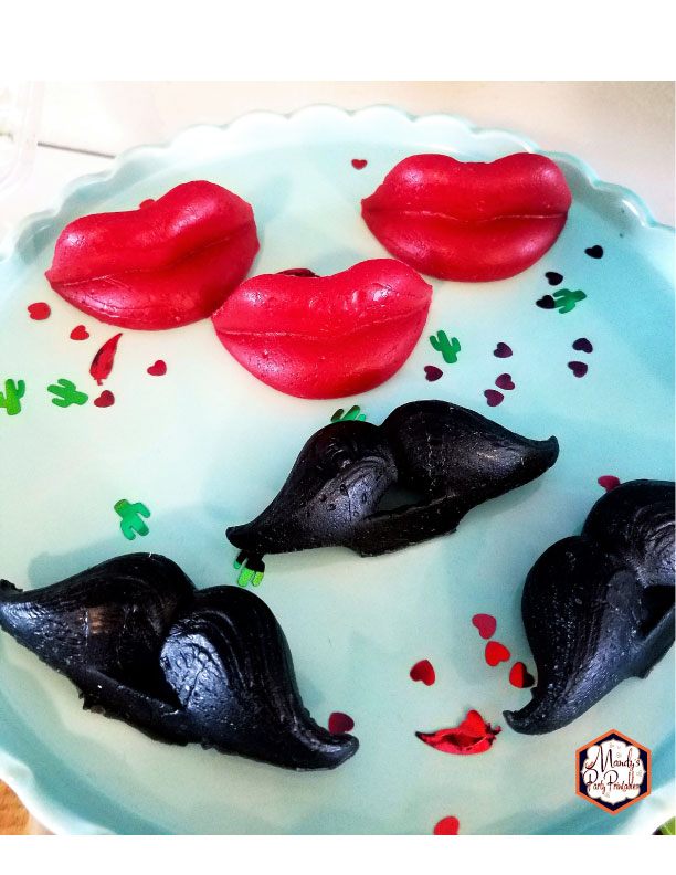 Wax lips and mustache's from a Taco Bout Love Valentine Taco Party | Mandy's Party Printables #valentineparty #tacoparty #tacoboutlove #ilovetacos #MPP #fiesta