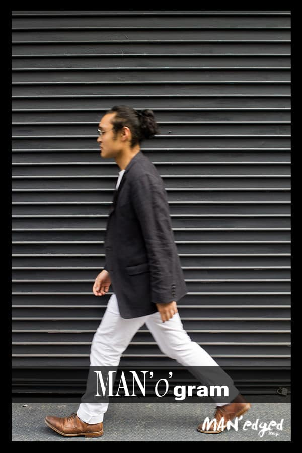 stylish guy walking, wearing gray blazer with white pants and brown shoes, a true men's style image