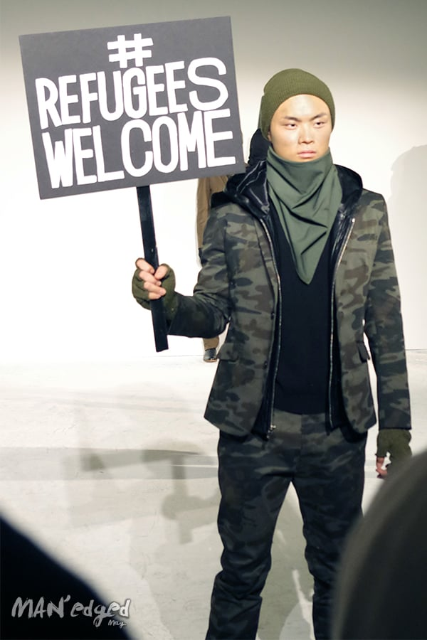 A model holds political statement sign at new york men's day.