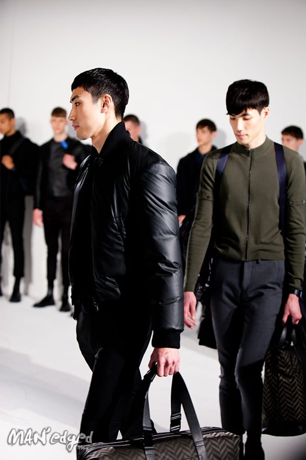 Model wearing a men's black puff coat.