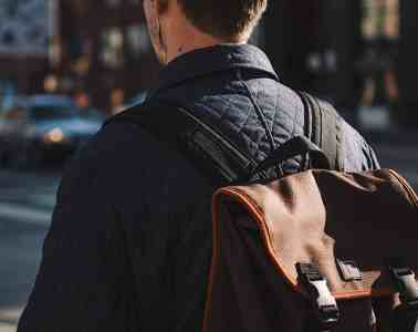 Young man wearing backpack for MAN'edged Magazine Editor's Pick