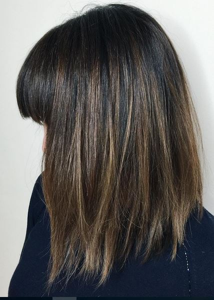 dark mocha brunette with subtle highlights