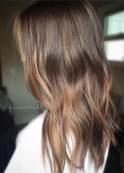 dark wood brunette with warm tones