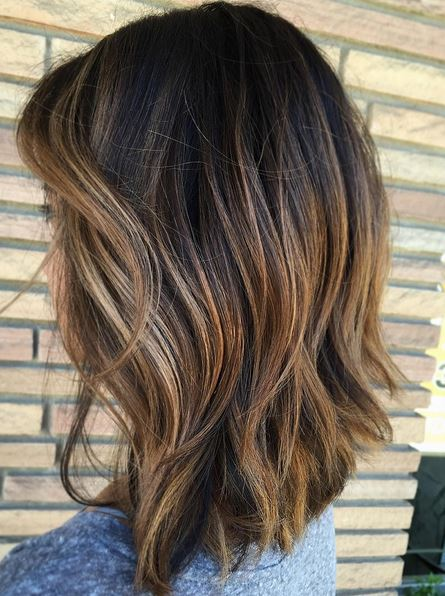 subtle highlights to add dimension on brunette hair