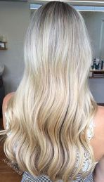 beige and butter blonde highlights via balayage