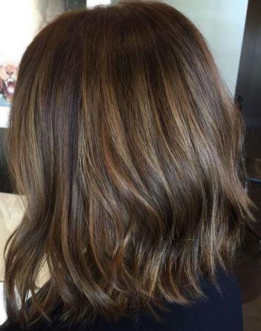 subtle brunette highlights on short hair
