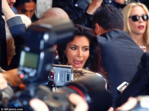 Kim Kardashian gets plagued by photographer's years ago in another incident from 2014. Photo courtesy of infphoto.com