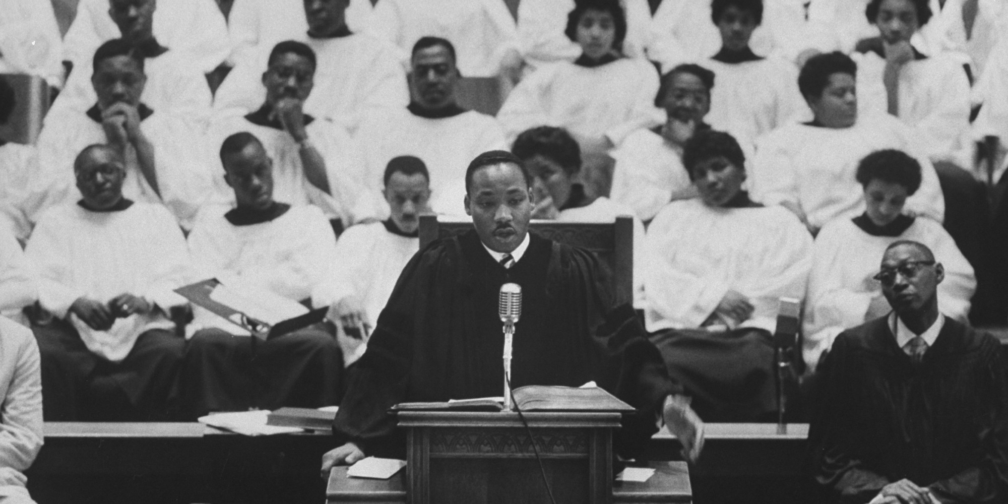 Martin Luther King Jr. (L) preaching in his church. (