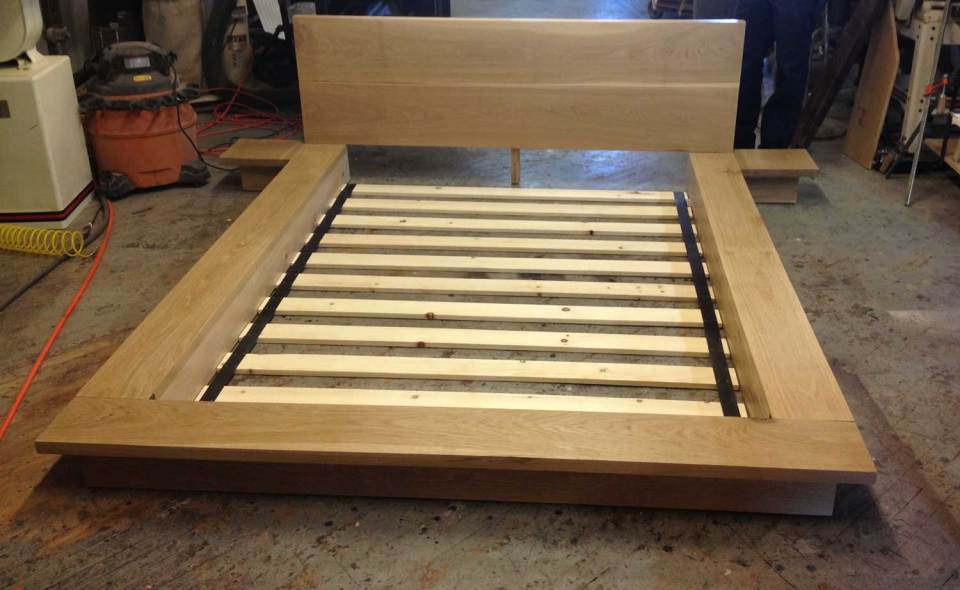 Custom hardwood White Oak Bedframe with accordion base slats in shop