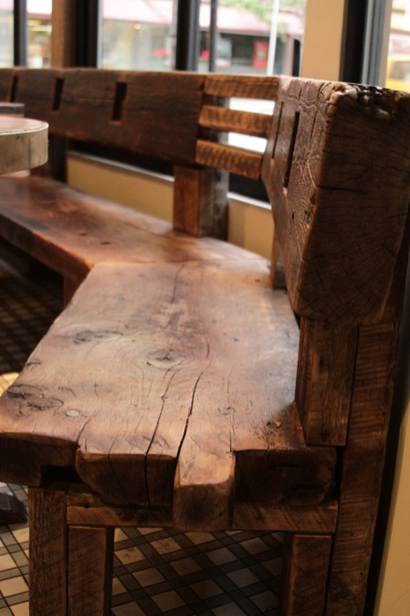 Angled rough hewn bench detail.