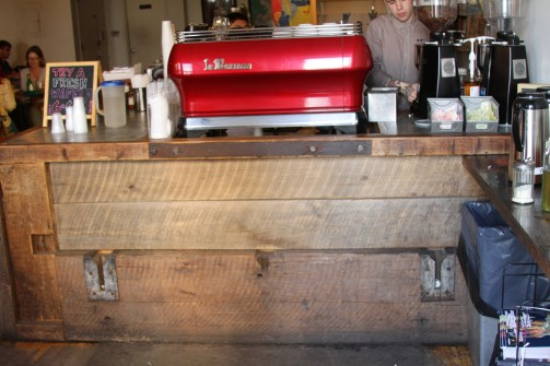Cafe bar counter detail, made with artistic, tinted cements and reclaimed woods.