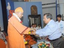 0029 0022 Srimat Swami Vishwatmanandaji Maharaj, Belur Math is being garlanded by Dr N Vinay Hegde