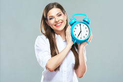 stock-photo-smiling-business-woman-hold-alarm-clock-isolated-portrait-of-young-woman-with-long-hair-isolated-368540159