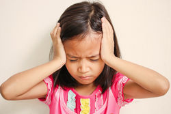 stock-photo-portrait-of-preschooler-girl-having-a-headache-326115887.jpg