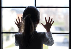 stock-photo-young-girl-at-window-in-partial-silhouette-hands-pressed-against-window-pensive-or-wanting-out-189988664.jpg