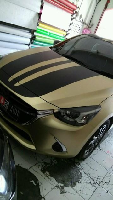stiker-mobil-bandung-mazda-rs-soft-gold-mangele