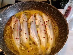 Moles in a pan with citrus and pepper rose