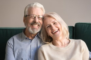 spouses having candid healthy toothy smile