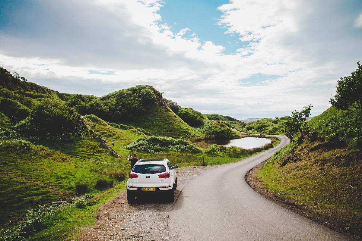 White car driving on a Scotland Road Trip