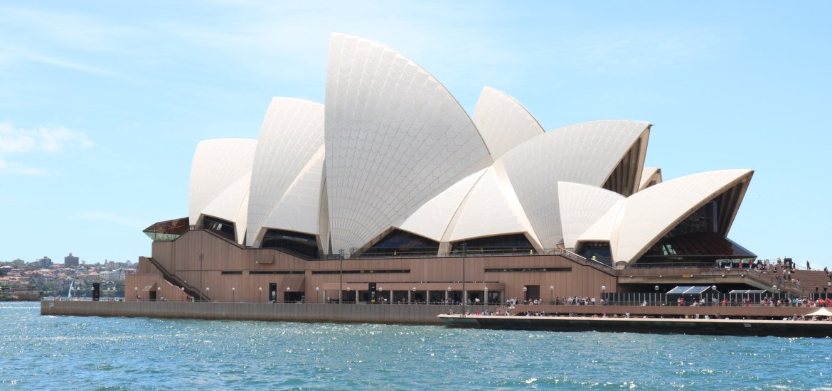 The famous Sydney Opera House glistens in the city's harbor.
