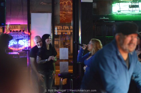 Karaoke singers and pool players at 7th Gear Bar