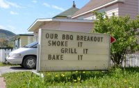 A sign advertises barbecue equipment. Corner Brook, Newfoundland.