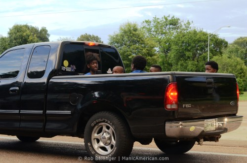 Young kids in the back of a pickup truck
