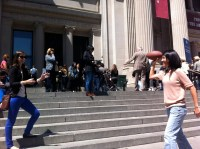 On the Met steps: Ju throws the football...