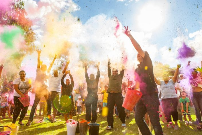 Holi Festival, Albury event photography of people throwing coloured powder in the air