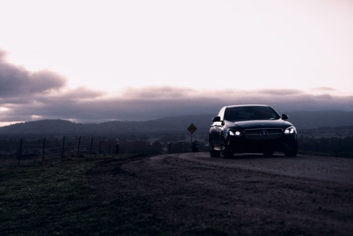 editorial shoot for wmedia for baker motors hall of fame mercedes benz on dirt road at sunrise